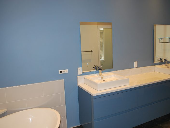 blue floating cabinets double sink
